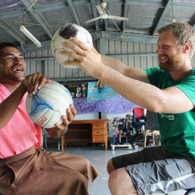 A graduate doing a Physiotherapy internship abroad works with a patient during a treatment session in Samoa.